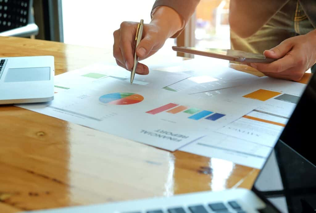 Businessmen analyze data with tablet and graphs from seo campaign