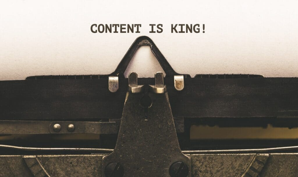 Content is King message on paper in old typewriter concept for seo